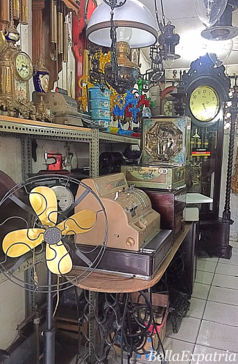 An antique store with antique fan and cash register